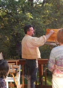 Image of artist Stefan Baumann doing a painting demonstration