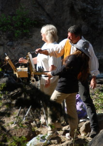 This photo of Stefan Baumann helping a Workshop participant with her painting on location at the Middle Falls.