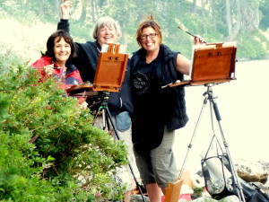 This photo is of three plein air painters having fun at Castle Lake along with other students from Redding and Mount Shasta Painting classes that are taught by Stefan Baumann.