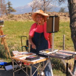 This is a photo of a participant oil painting on location at The Grand View Workshop as she sets up her equipment.